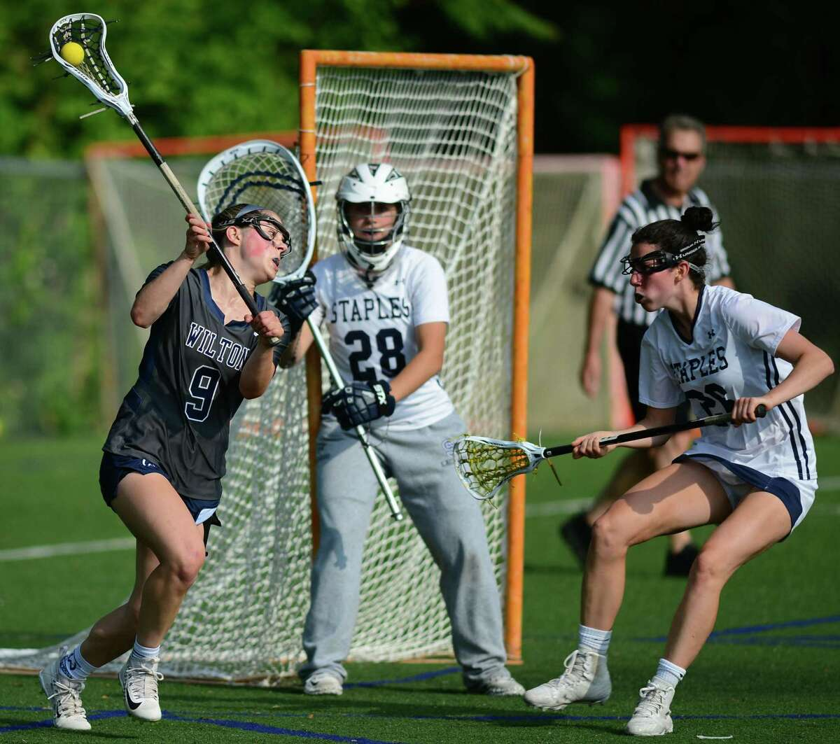 Warrior #9 Sophia Sudano looks to shoot on goal tended by Wrecker #28 Sara DiGiovanni as the Staples High School Wreckers take on the Wilton High School Warriors in their CIAC Class L girls lacrosse state tournament quarterfinal game at Staples High School in Westport, Conn.