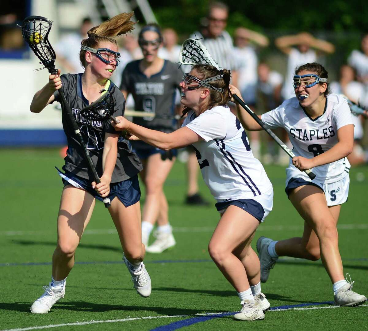 Warrior #11 Olivia Gladstein tries to get a shot past Wrecker #22 Alexa Mysel as the Staples High School Wreckers take on the Wilton High School Warriors in their CIAC Class L girls lacrosse state tournament quarterfinal game at Staples High School in Westport, Conn.