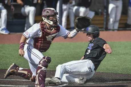 Duke's Chris Crabtree scores ahead of the throw to Texas A&M catcher Mikey Hoehner during Friday's NCAA regional game at Morgantown, W.Va.