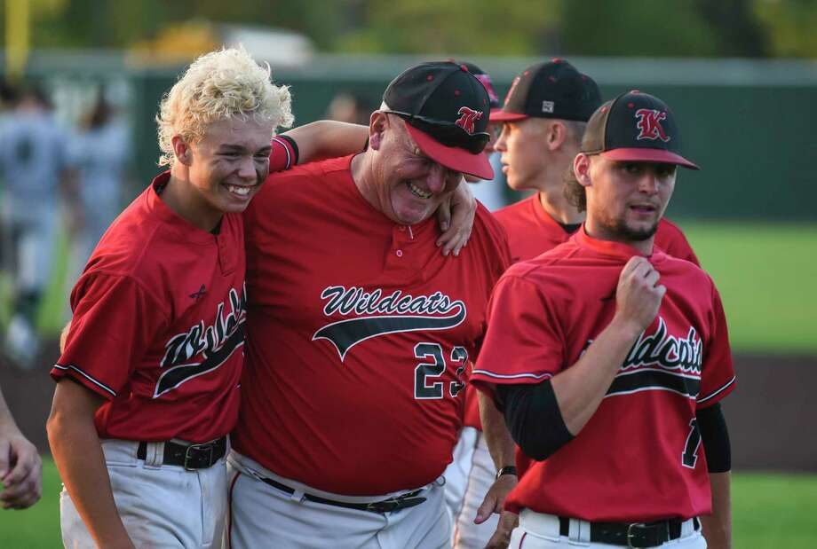 Kirbyville players and coaches celebrate after the Class 3A regional finals in Humble on Friday night against Pollok Central. The Wildcats won 12-2 against Bulldogs. Photo taken on Friday, 05/31/19. Ryan Welch/The Enterprise Photo: Ryan Welch, The Enterprise / © 2019 Beaumont Enterprise