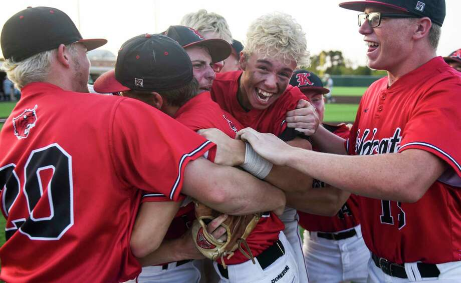 Kirbyville players celebrate after the Class 3A regional finals in Humble on Friday night against Pollok Central. The Wildcats won 12-2 against Bulldogs. Photo taken on Friday, 05/31/19. Ryan Welch/The Enterprise Photo: Ryan Welch, The Enterprise / © 2019 Beaumont Enterprise