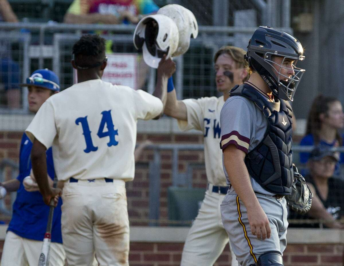 Magnolia West catcher Brody Szako (16) is seen as Alec Barrett (14) of Georgetown scores on Zach Wittenton's two-out single in the first inning of Game 2 during a Region III-5A final series at Blue Bell Park on the campus of Texas A&M University, Friday, May 31, 2019, in College Station.