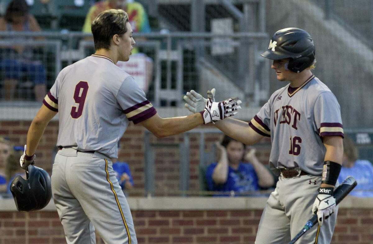 Brody Szako (16) of Magnolia West gets a high-five from Connor Phillips after Phillips' solo home run in the fourth inning of Game 2 during a Region III-5A final series at Blue Bell Park on the campus of Texas A&M University, Friday, May 31, 2019, in College Station. Szako hit a solo home run himself in the next at bat.