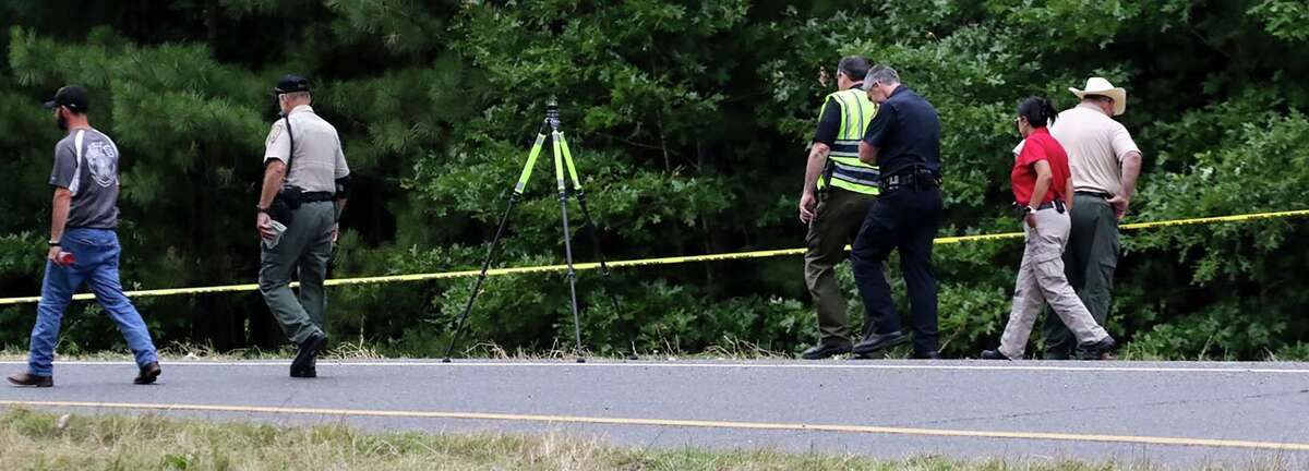 Police officers investigate the remains of a body that was found by workers cutting grass on Friday, May 31, 2019 near Hope, Ark. The remains were found in trash bags found off the Fulton exit (exit 18) of Interstate 30 near Hope.