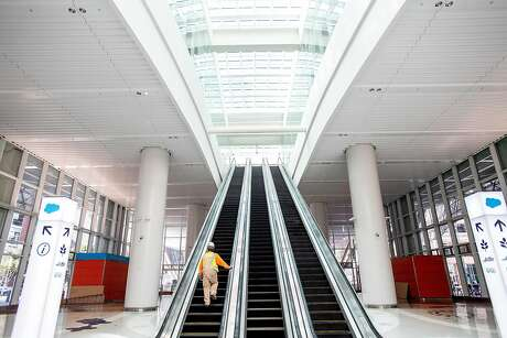 A worker walks up an escalator at the Transbay Transit Center on Wednesday, April 10, 2019, in San Francisco. The transit hub remains closed as work continues to repair cracked support girders.