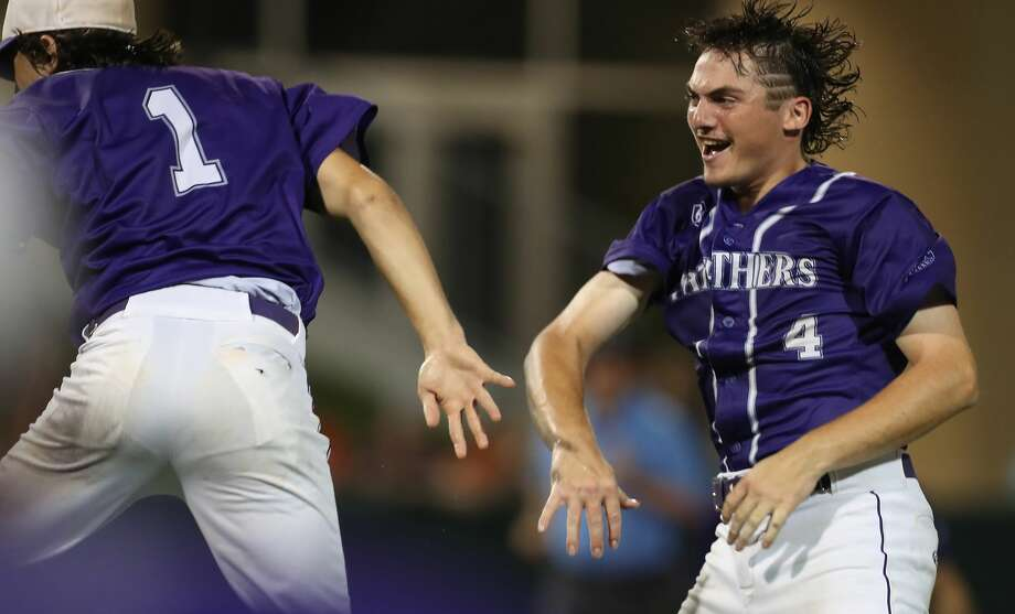 Ridge Point pitcher #4 Hayde Key celebrates with teammate #1 Preston Steszewski and players after defeating Kingwood in the baseball regional final Game 2 Friday, May 31, 2019, in Houston. Photo: Steve Gonzales/Staff Photographer