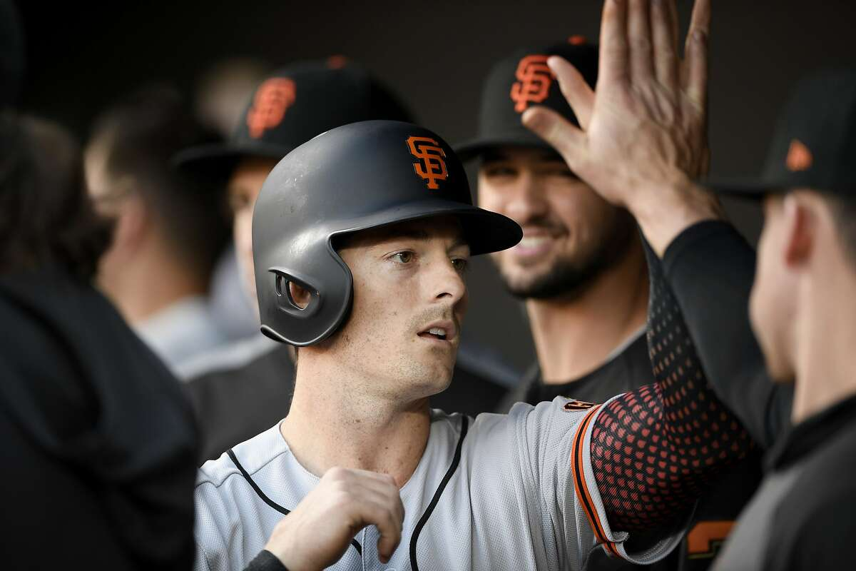 San Francisco Giants' Mike Yastrzemski celebrates in the dugout after he scored on a single by Buster Posey during the first inning of a baseball game against the Baltimore Orioles, Friday, May 31, 2019, in Baltimore. (AP Photo/Nick Wass)