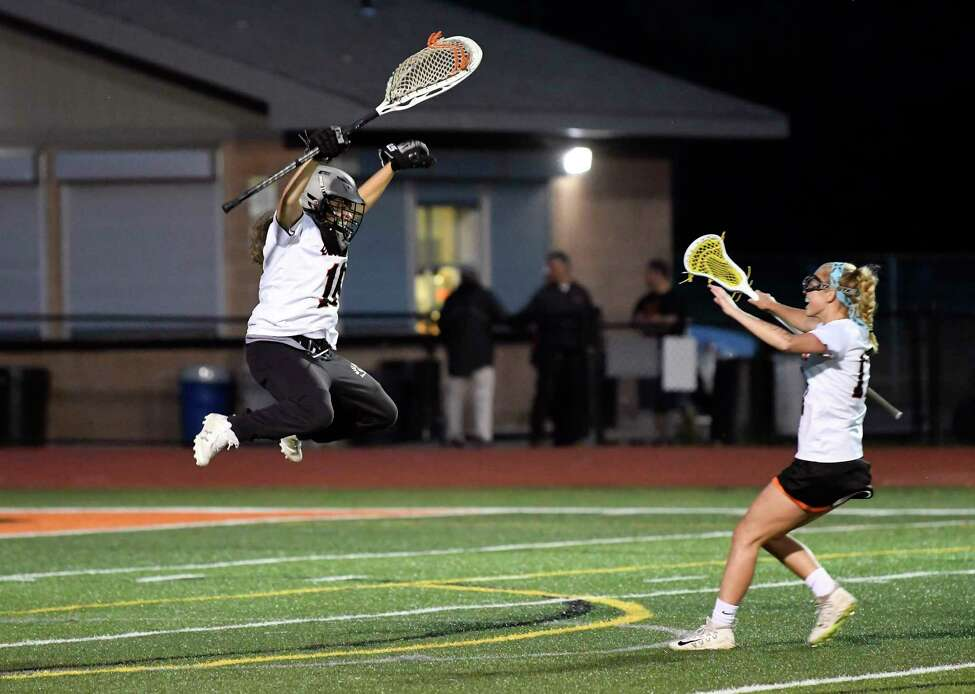 Bethlehem's Mae Healy (10) and teammate Emma Sinuc (17) celebrate a 15-9 win against North Rockwell during a Class A girls' lacrosse state quarterfinal game Friday, May 31, 2019, in Rotterdam, N.Y. Bethlehem won (Hans Pennink / Special to the Times Union)