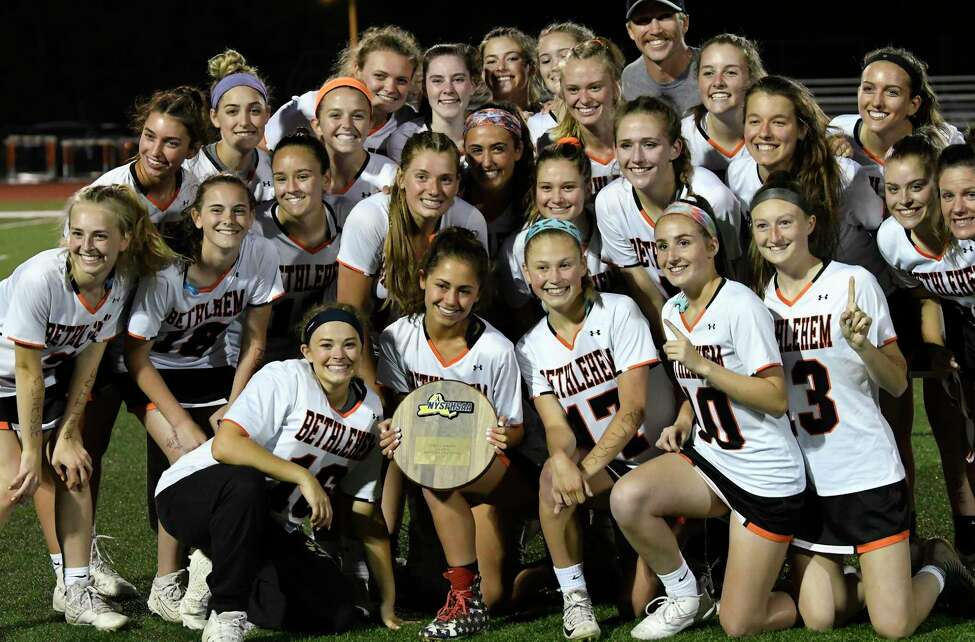 Bethlehem players celebrate a 15-9 win against North Rockwell during a Class A girls' lacrosse state quarterfinal game Friday, May 31, 2019, in Rotterdam, N.Y. Bethlehem won (Hans Pennink / Special to the Times Union)