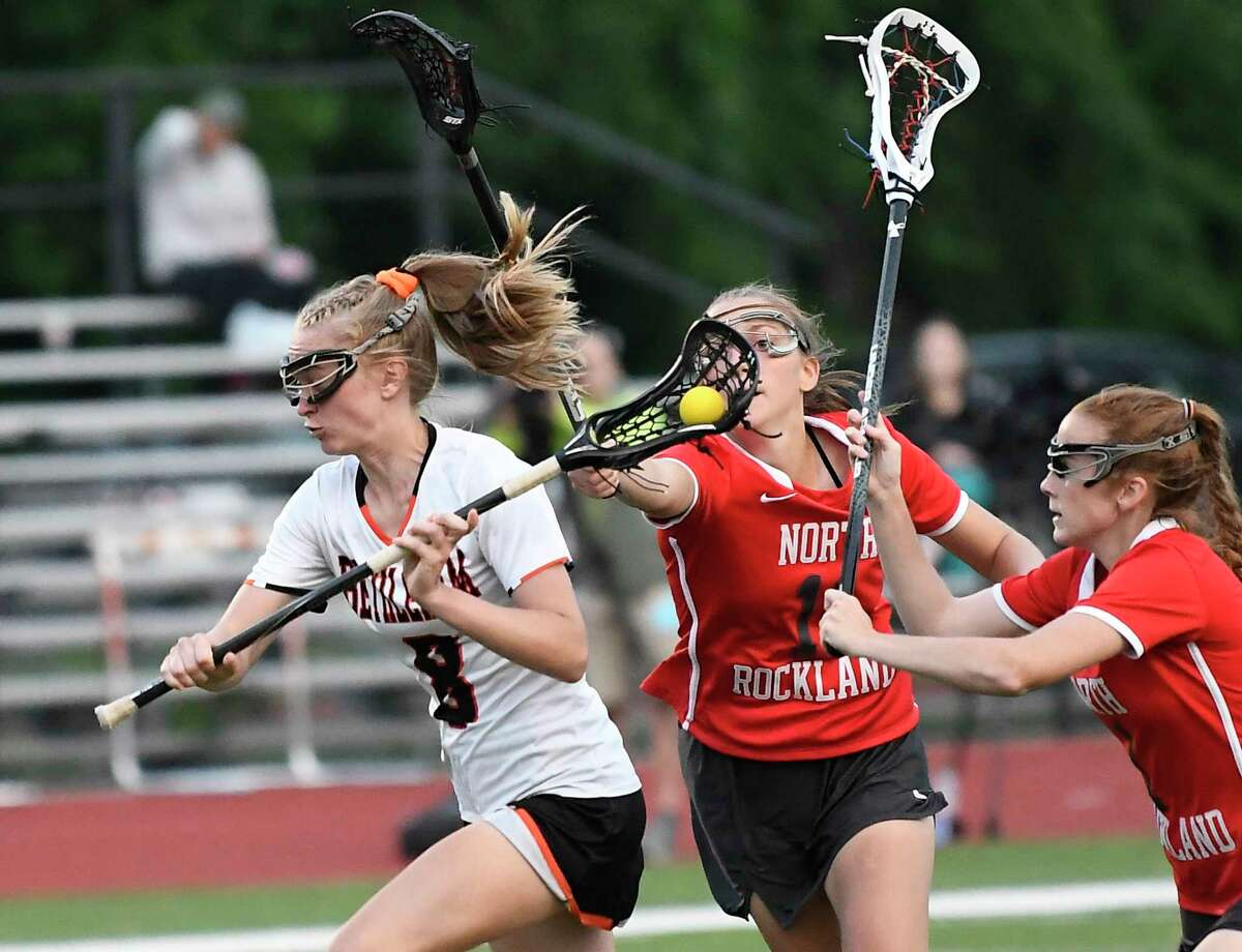 Bethlehem's Avery Jones (8) moves the in front of North Rockwell defenders during a Class A girls' lacrosse state quarterfinal game Friday, May 31, 2019, in Rotterdam, N.Y. Bethlehem won 15-9. (Hans Pennink / Special to the Times Union)
