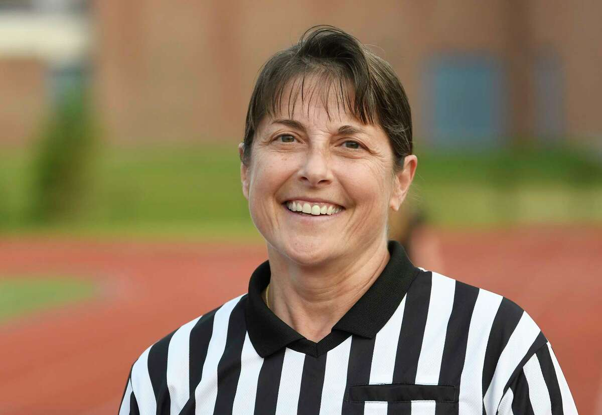 Lacrosse official Mara Wager poses for a photograph before officiating during a Class A girls' lacrosse state quarterfinal game between Bethlehem and North Rockwell Friday, May 31, 2019, in Rotterdam, N.Y. Bethlehem won 15-9. (Hans Pennink / Special to the Times Union)