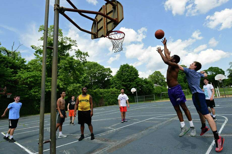 A group of friends plays pick up basketball at Fitch Playground Friday, May 31, 2019, in Norwalk, Conn. Photo: Erik Trautmann / Hearst Connecticut Media / Norwalk Hour
