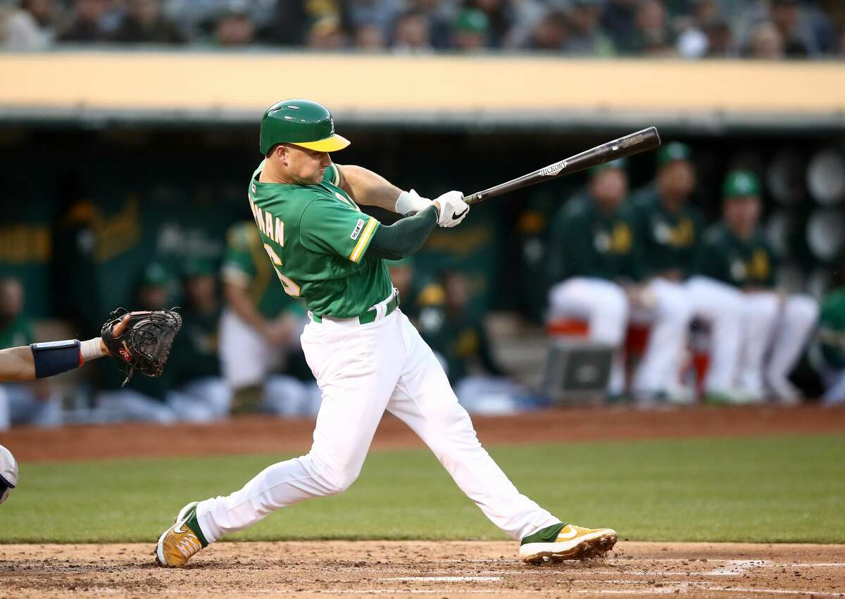 OAKLAND, CALIFORNIA - MAY 31: Matt Chapman #26 of the Oakland Athletics hits a two-run home run in the third inning against the Houston Astros at Oakland-Alameda County Coliseum on May 31, 2019 in Oakland, California. (Photo by Ezra Shaw/Getty Images)