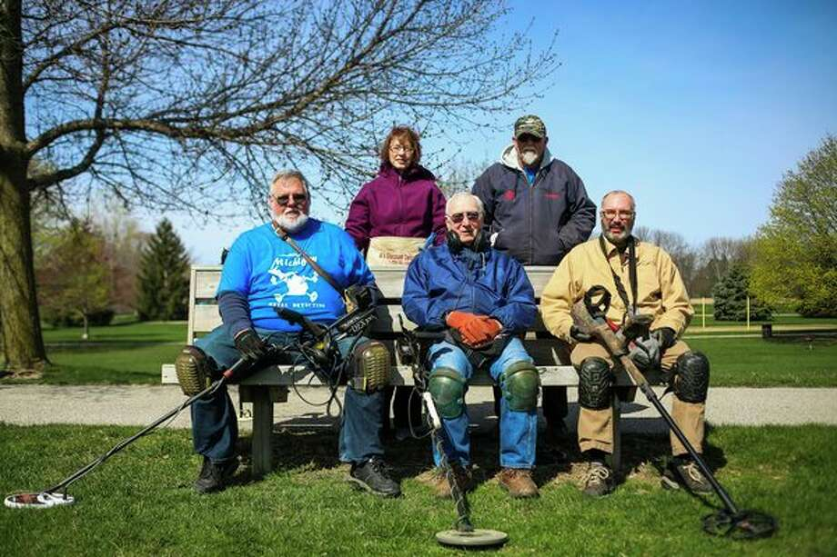 Clockwise from back left, Vicky Louks of Saginaw, Kerry Koch of Millington, Rich Holbrook of Midland, Lee Walkowski of Midland and Jim Mullen of Bay City pose for a photo during a gathering of the Mid Michigan Metal Detecting Club on Saturday, April 27 at Williams Township Park in Auburn. (Katy Kildee/kkildee@mdn.net)