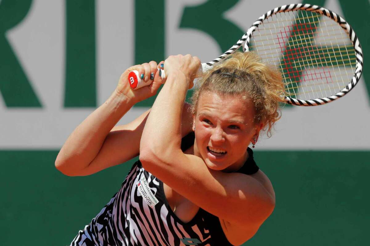 Katerina Siniakova of the Czech Republic plays a shot against Japan's Naomi Osaka during their third round match of the French Open tennis tournament at the Roland Garros stadium in Paris, Saturday, June 1, 2019.