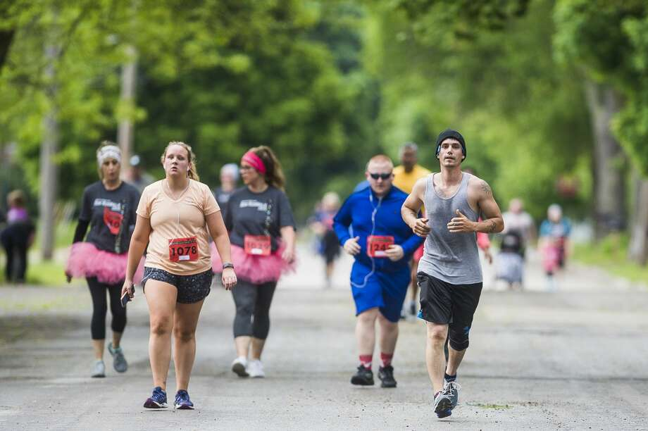 Runners and walkers participate in the Dow RunWalk on Saturday, June 1, 2019 in Midland. (Katy Kildee/kkildee@mdn.net) Photo: (Katy Kildee/kkildee@mdn.net)