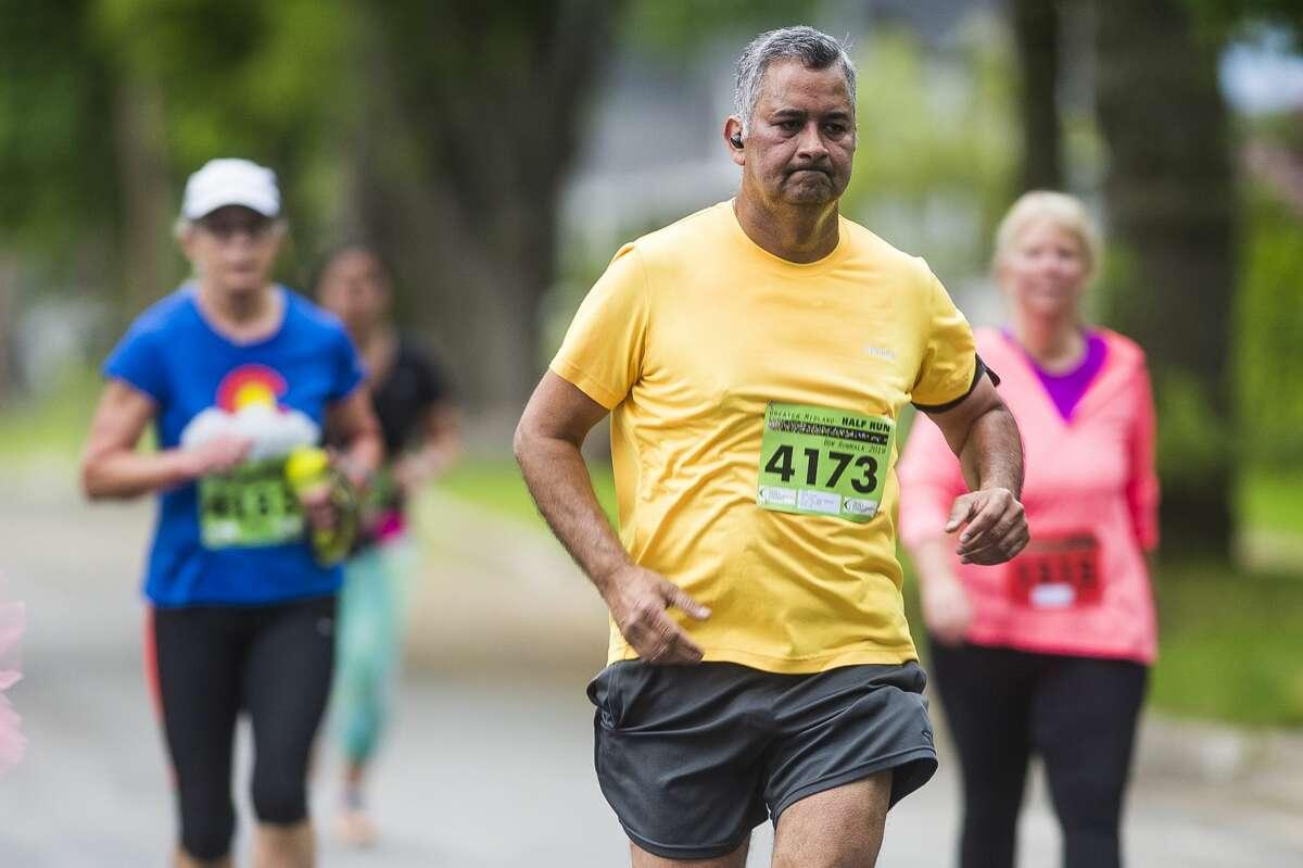 Runners and walkers participate in the Dow RunWalk on Saturday, June 1, 2019 in Midland. (Katy Kildee/kkildee@mdn.net)
