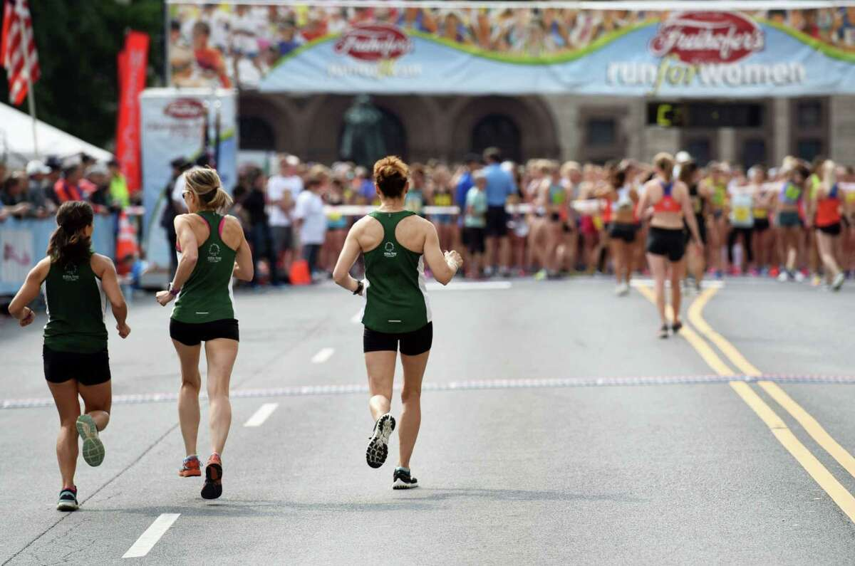 Runners warmup before the start of the Freihofer's Run For Women on Saturday, June 1, 2019 in Albany, NY. (Phoebe Sheehan/Times Union)