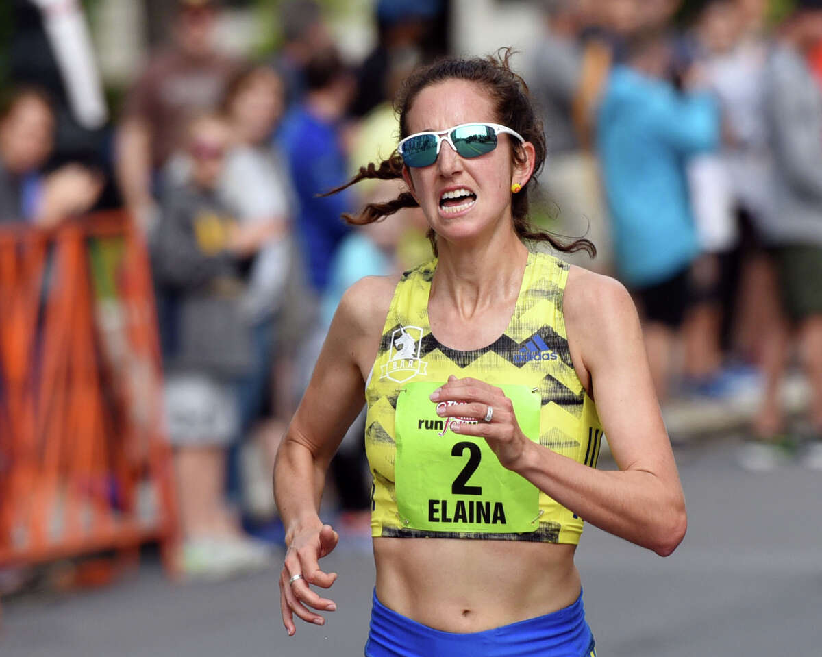 Elaina Tabb of Watertown, MA, left sprints toward the finish line to place first during the Freihofer's Run For Women on Saturday, June 1, 2019 in Albany, NY. (Phoebe Sheehan/Times Union)