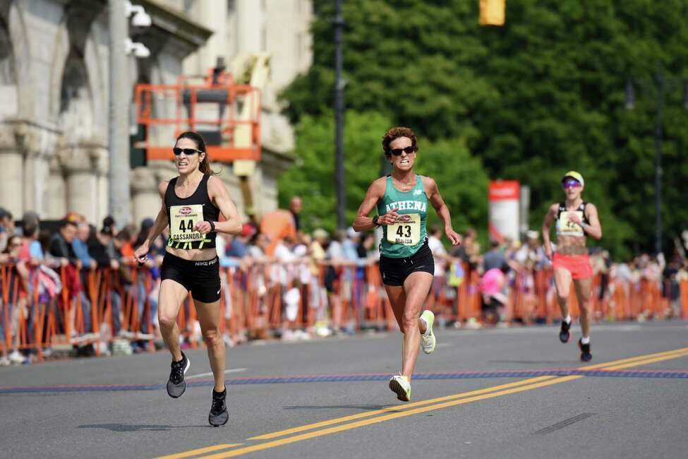 From left, masters runners #44 Cassandra Henkiel, #43 Marisa Sutera Strange and #42 Christy Peterson sprint toward the finish during the Freihofer's Run For Women on Saturday, June 1, 2019 in Albany, NY. (Phoebe Sheehan/Times Union)