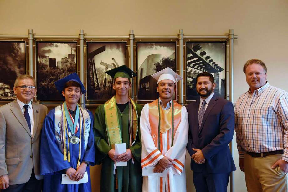 Miguel Conchas, Joshua Ramos, Aaron Izaguirre, Reynaldo Guerra, Tito Gonzalez and Cliffe Killam pose for a photo during the Spirit of Laredo Scholarship ceremony at the Killam office on Friday. Photo: Christian Alejandro Ocampo / Laredo Morning Times / Laredo Morning Times