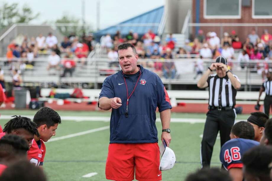 Dawson head football coach Mike Allison talks to his team at the Eagles' spring football game. Dawson is bidding for a repeat trip to the playoffs this fall in Allison's second year as head coach. Photo: Hendricks Rockography / Lloyd Hendricks