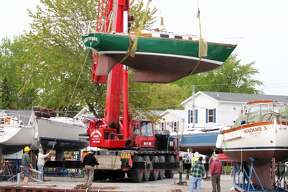 The Huron Yacht Club lifts boats with cranes and launches them into the water. The yacht club is located in Caseville, Michigan.
