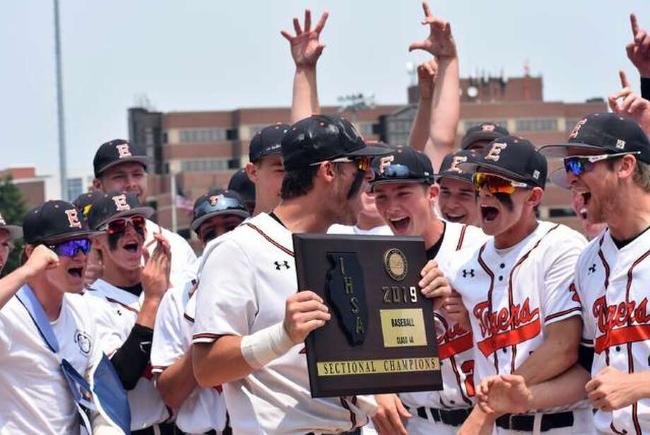 Drake Westcott, holding the plaque, and the Edwardsville Tigers celebrate their win over Normal West on Saturday to win the Class 4A Illinois Wesleyan Sectional championship. Photo: Matt Kamp/The Intelligencer