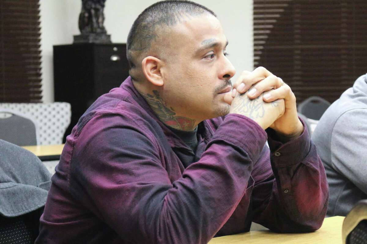 Beto Chavez, who works with the Firehouse Community Development Corporation on conflict resolution in San Jose, listens to Pastor Sonny Lara.