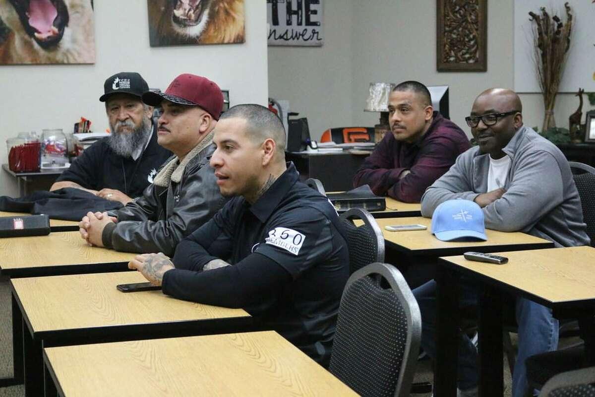 Tony Herrera (left), Angel Bejarano, Tony Sanchez, Beto Chavez and Lamont Jones listen to Pastor Sonny Lara.