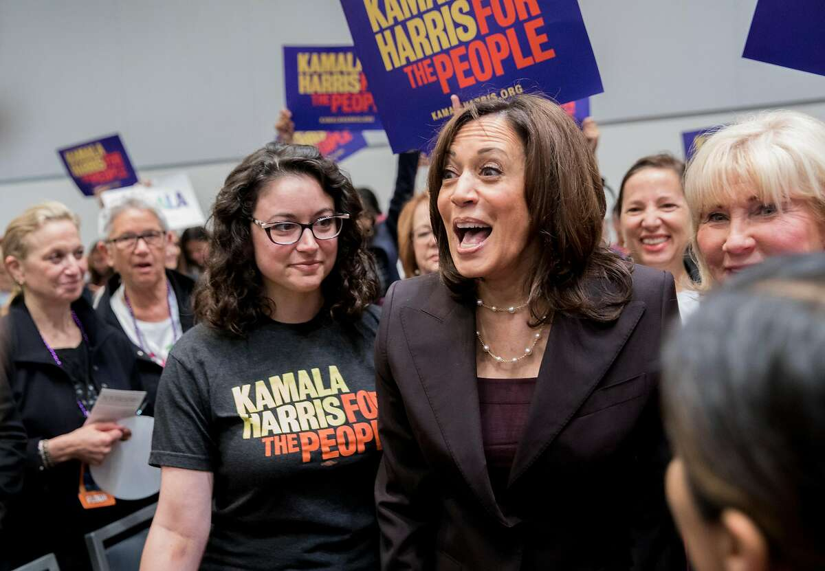 Democratic presidential candidate Senator Kamala Harris greets members of the audience before taking the stage during the Women's Caucus at the California Democratic Convention held at Moscone North in San Francisco, Calif. Saturday, June 1, 2019.