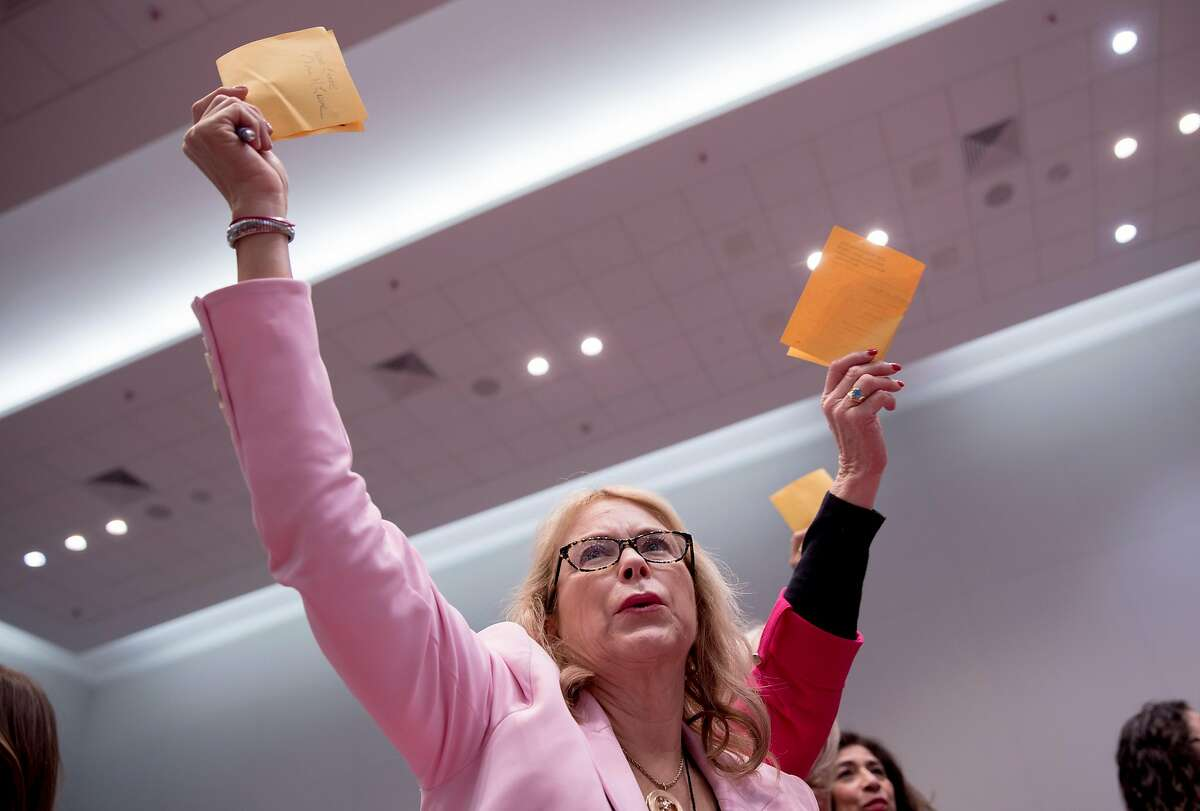 Nonie Greene holds up her ballot to be collected during the Women's Caucus at the California Democratic Convention held at Moscone North in San Francisco, Calif. Saturday, June 1, 2019.