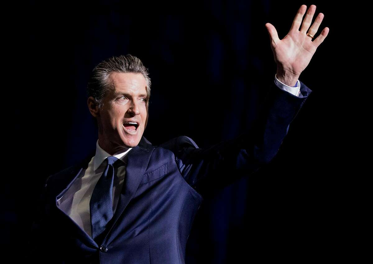 California Governor Gavin Newsom walks onto the stage during the general session of the California Democratic Convention held at Moscone North in San Francisco.