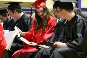 Ascent High School hosted its graduation ceremony Saturday afternoon inside Bad Axe Middle School's gymnasium. Twenty-two seniors received their high school diplomas.