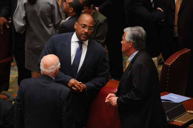 State Sen. John Sampson, left, , the Democratic conference leader, talks to Dean Skelos, the Republican minority leader, before the start of the Senate's special session in the Capitol on Wednesday evening July 28, 2010.   (Philip Kamrass / Times Union) Photo: PHILIP KAMRASS