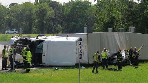 Photos: Truck lands on car at Thruway interchange - Times Union