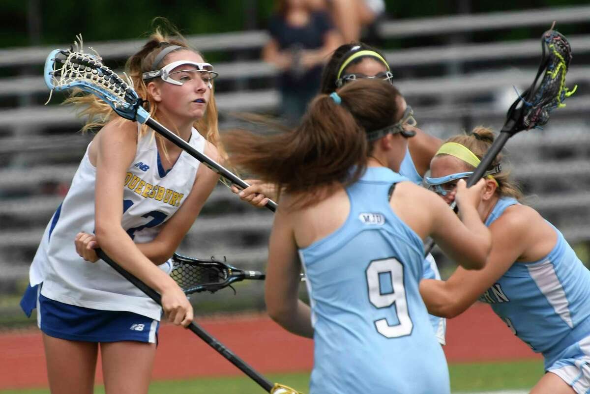 Queensbury's Audrey Murphy ,left, scores against Suffern during a Class B girls' lacrosse state quarterfinal game Saturday, June 1, 2019, in Rotterdam, N.Y.