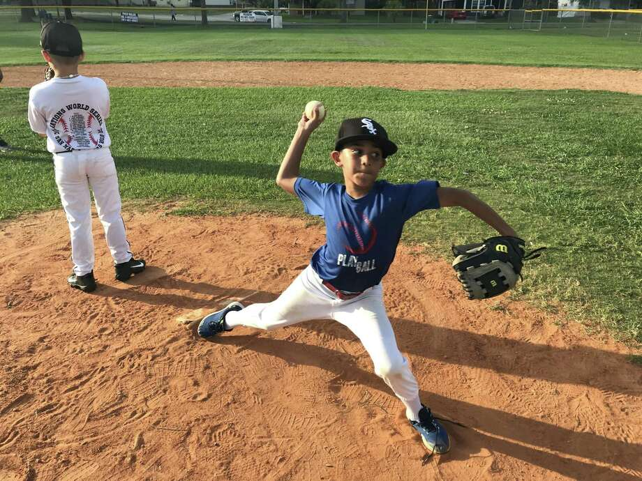 Pasadena 10U all-star pitcher Nate Rincon showed nice velocity on his fastball during workouts this past week at Strawberry Park. Hopefully, he'll be a pitcher for Pasadena or Sam Rayburn High School some day. Photo: Robert Avery