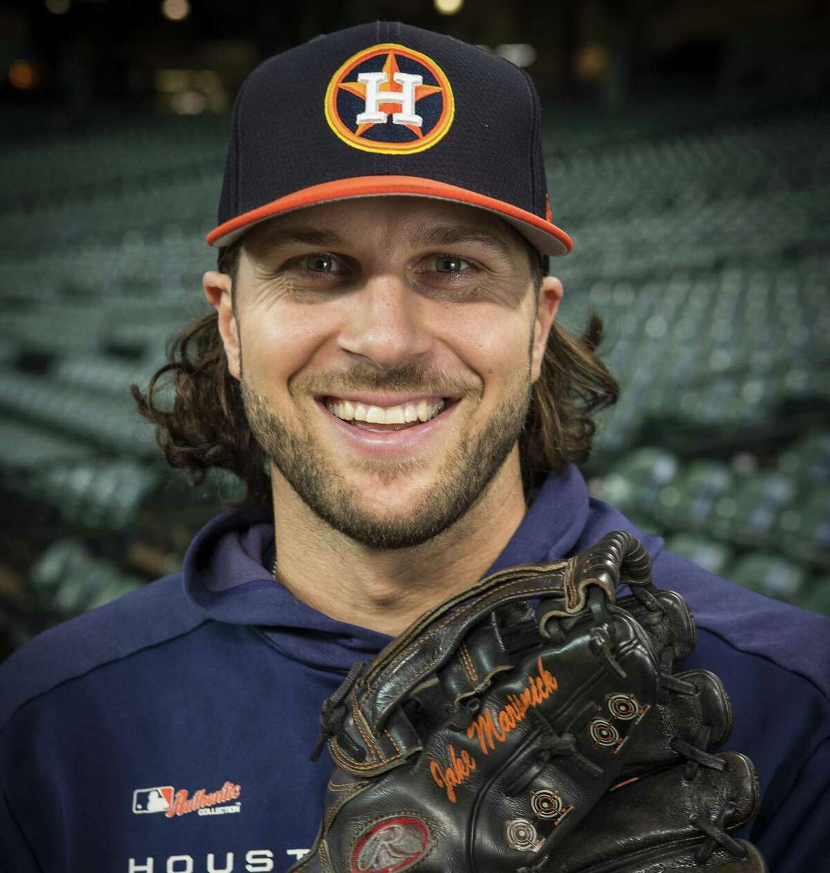 Houston Astros outfielder Jake Marisnick shows off his outfielders glove, that features four small targets on the outside of the glove that he uses to focus, at Minute Maid Park on Wednesday, May 29, 2019, in Houston.