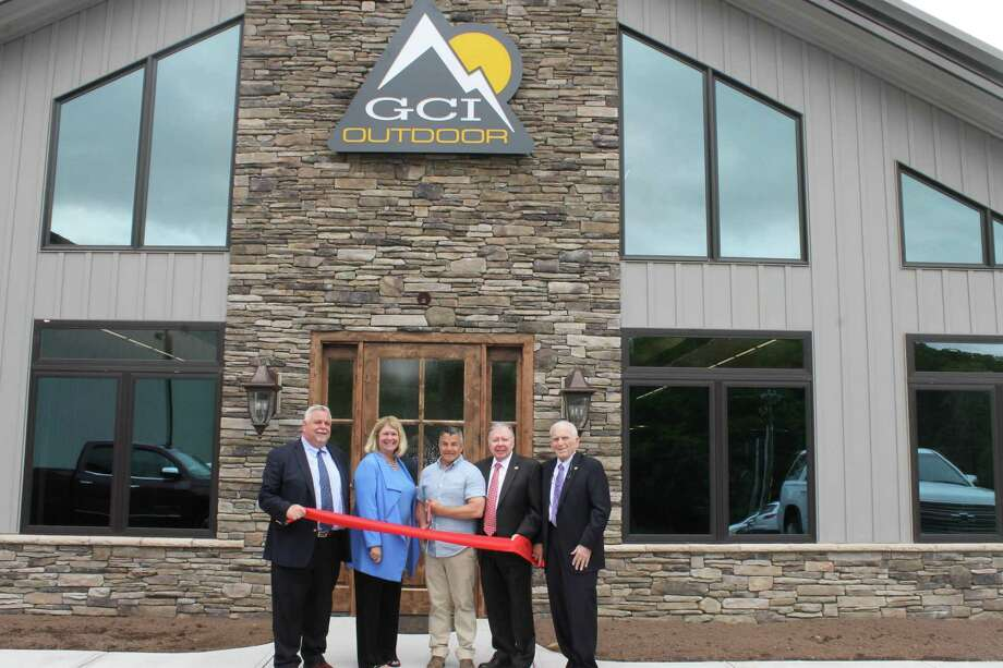 GCI Outdoor held a ribbon cutting at its new facility at 457 Killingworth Road in Higganum May 29. From left are Middlesex County Chamber of Commerce Vice Chairman Don DeVivo, Haddam First Selectwoman Lizz Milardo, GCI Co-President Jeff Polke, Chamber Chairman Jay Polke and President Larry McHugh. Photo: Contributed Photo