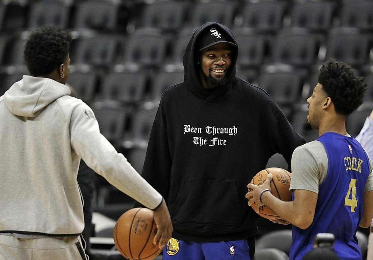 Kevin Durant (35) on the court with Quinn Cook (4) and Jordan Bell (2) as the Golden State Warriors and Toronto Raptors practiced during an off day between Games 1 and 2 of the 2019 NBA Finals at Scotiabank Arena in Toronto, Ontario, Canada, on Saturday, June 1, 2019. The Raptors lead the series 1-0.