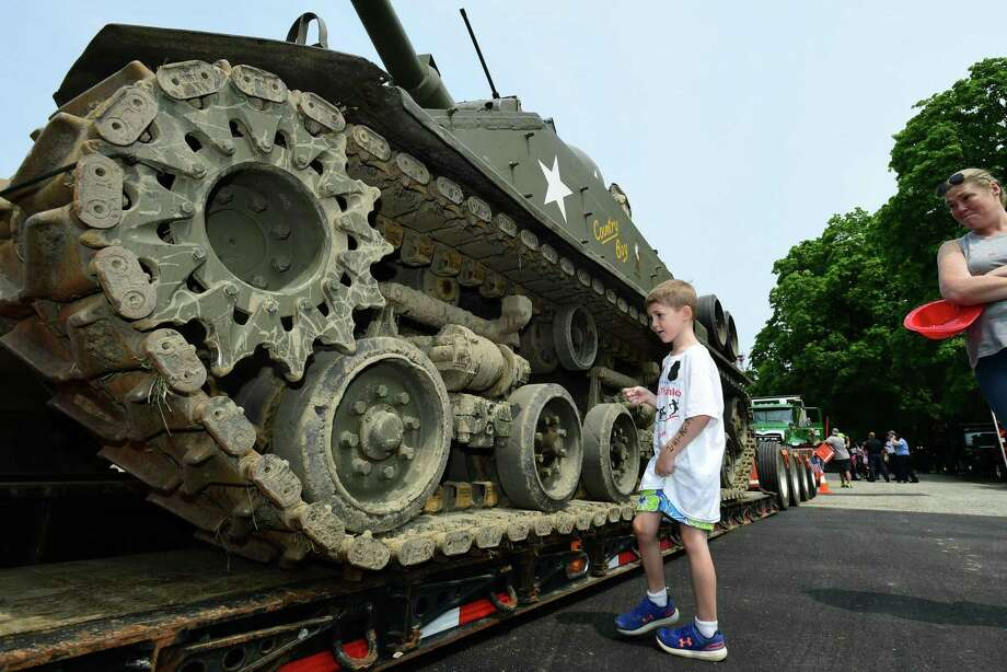 Above, Norwalk resident Travis Hiscock, 6, looks at a real WWll era Sherman tank during The American Legion Post 12, Weekend at the Post — A Thank You To All Our Veterans Open House on Saturday in Norwalk. This year is the American Legion's & Post 12's 100th anniversary. Photo: Erik Trautmann / Hearst Connecticut Media / Norwalk Hour