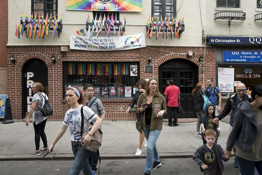 The site of the 1969 uprising at the Stonewall Inn in New York City's West Village has become a tourist attraction. Photo: Mark Lennihan / Associated Press 2017