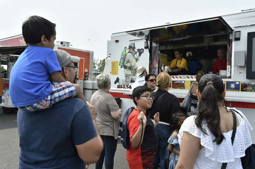 New Haven Connecticut - Saturday, June 1, 2019: The New Haven Food Truck Festival Saturday afternoon on Long Wharf Drive along the New Haven Harbor shoreline.