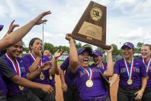 Angleton pitcher Aaliyah Garcia (7) celebrates a 8-1 over Calallen with the championship trophy and her MVP trophy during the UIL Class 5A state softball championship in Austin, Saturday, June 1, 2019. (Stephen Spillman / for Houston Chronicle)
