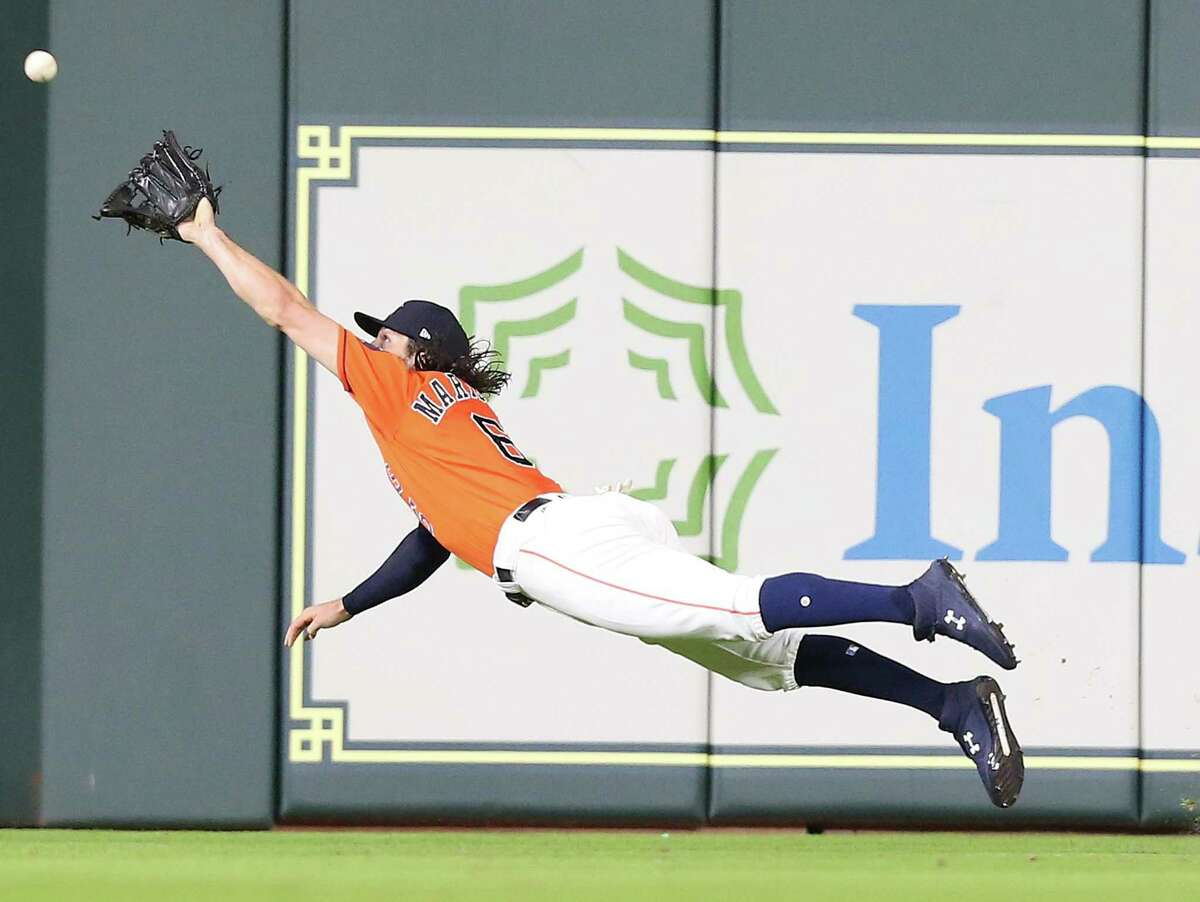 In what is becoming an almost daily occurrence, Astros center fielder Jake Marisnick extends his body parallel to the ground in order to make the impossible catch.