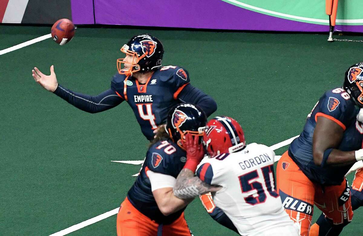 Albany Empire quarterback Tommy Grady (4) bobbles the football during a arena football game against the Washington Valor Saturday, June 1, 2019, in Albany, N.Y. (Hans Pennink / Special to the Times Union)