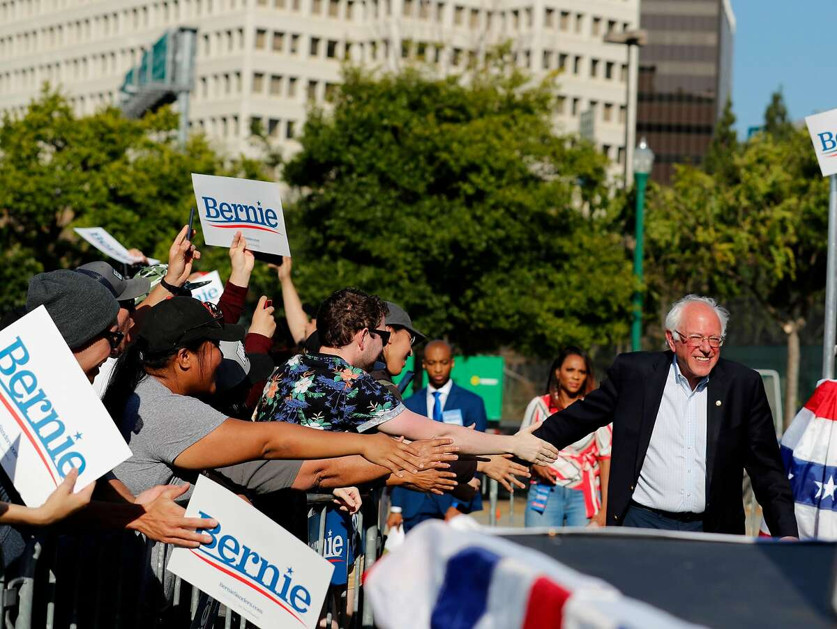 U.S. Senator and presidential candidate, Bernie Sanders makes is way onto the stage at a campaign rally in San Jose, California on June1, 2019.