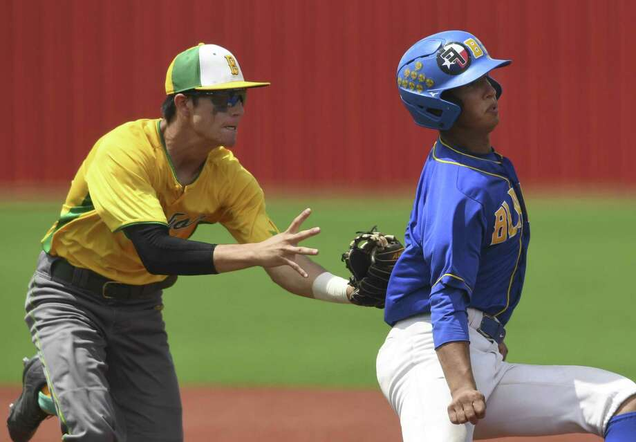 Blanco's Eddie Calconcit is tagged out by Bishop's Kobe Jaramillo after being caught in a rundown during Game 2 of the 3A regional final playoff series in Jourdanton on Saturday, June 1, 2019. Photo: Billy Calzada, Staff / Staff Photographer / Billy Calzada