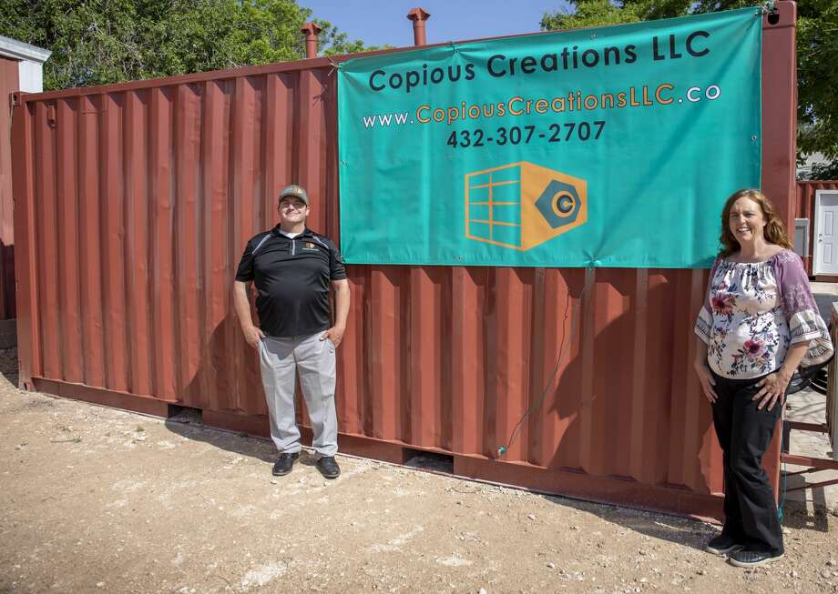 Owners Matt Boden and Angela Wright-Webb of Copious Creation in front of one of their refurbished show storage containers.  Jacy Lewis/191 News Photo: Jacy Lewis/191 News